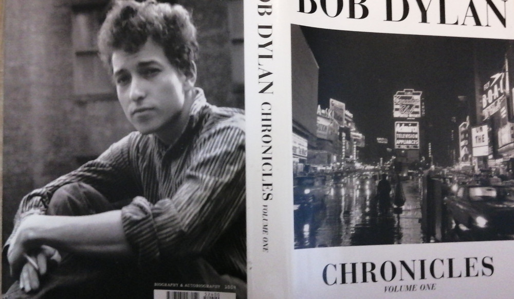 Partial photo of both front and back cover of Bob Dylan's Chronicles Volume one
