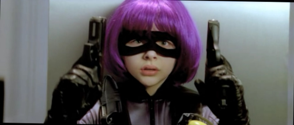 Screenshot from Kick-Ass: Hit-girl close-up holding two pistols.