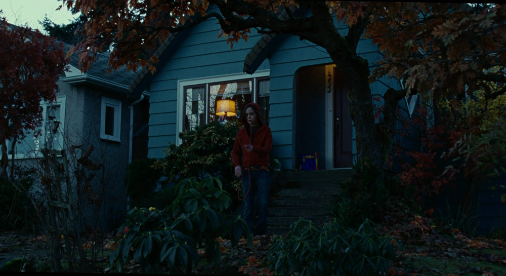 Screenshot of Ellen Page from Juno, outside of her home