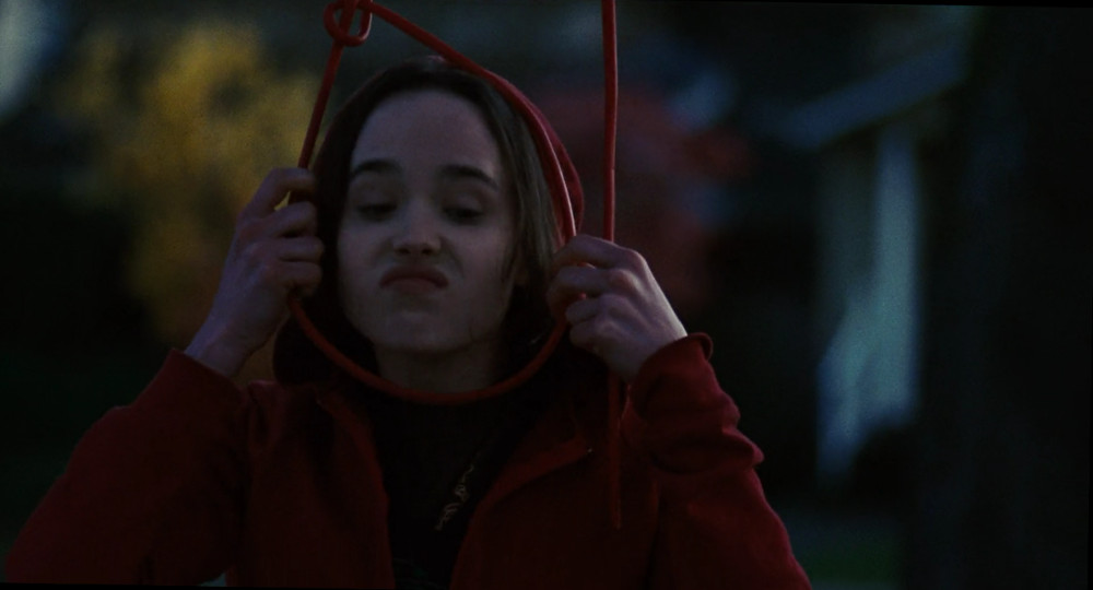 Screenshot of Ellen Page from Juno, pretending to hang herself from a tree