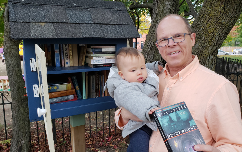 photo of Geoffrey Dow with Baobao returning Neverwhere to his local little library